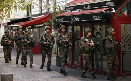 French soldiers worked to secure the area after gunfire was exchanged with the suspected terrorists during the early-morning raid.