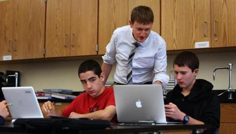 Physics teacher David Shapiro worked with students Jeff Marsh (left) and Connor Giersch at Natick High School.