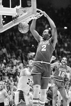 FILE - In this June 1, 1983, file photo, Philadelphia 76ers' Moses Malone slams home two of his 24 points in a NBA basketball playoff game against the Los Angeles Lakers in Los Angeles. Malone, a three-time NBA MVP and one of basketball�s most ferocious rebounders, died Sunday, Sept. 13, 2015. He was 60. (AP Photo/File)