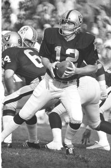 Ken Stabler, quarterback for the Oakland Raiders, looks for a receiver during game action, 1974. (AP Photo) 10sunfoot_chart