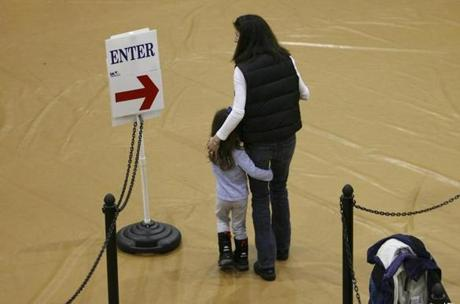 A woman waited in line to vote in Hopkinton in 2008.