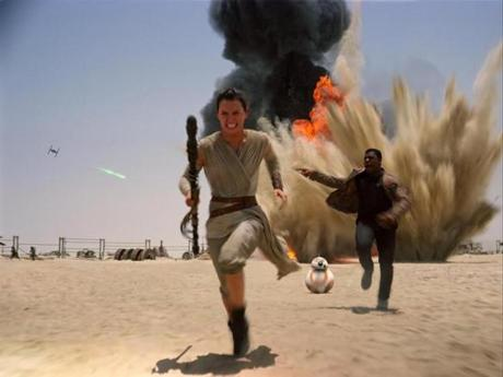 "Daisey Ridley as Rey, left, and John Boyega as Finn, in a scene from ""Star Wars: The Force Awakens."""