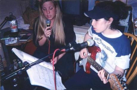 "Amy Winehouse, right, in a scene from the film, ""Amy."""