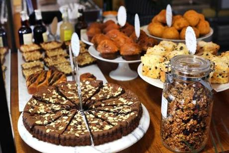 Dorchester-02/19/16 The Homestead Cafe on Dorchester Ave. A display of pastry for sale including a gluten-friendly chocolate almond tart, (left fore). Boston Globe staff photo by John Tlumacki(lifestyle)