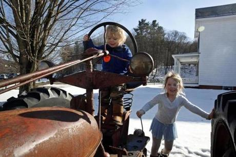 It was a good day day for Finn, 2, and Sophia, 6, Poggi to play at being farmers on the tractor outside the barn.