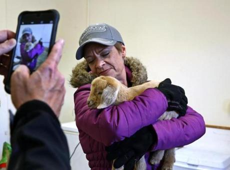 Mary Harwell, of Greensboro, N.C., held Cagney, a baby goat who is only one day old.