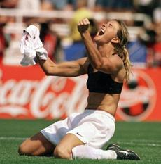 FILE - In this July 10, 1999 file photo, the United States' Brandi Chastain celebrates by taking off her jersey after kicking in the game-winning penalty shootout goal against China in the Women's World Cup Final at the Rose Bowl in Pasadena, Calif. Tony DiCicco sees more than a few similarities to his 1999 team, the last group of Americans to win the World Cup: heart, desire, the refusal to give up. (AP Photo/The San Francisco Examiner, Lacy Atkins, File) MANDATORY CREDIT. SAN FRANCISCO CHRONICLE OUT