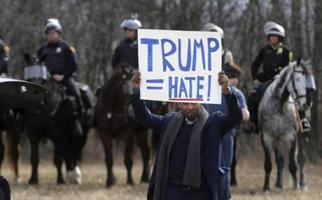 An anti-Trump protester held a sign in front of mounted police outside a Cleveland rally earlier this month.
