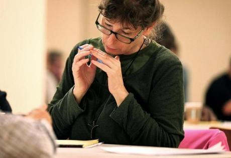 05/03/2016 -Boston, MA- Madonna Arsenault (cq) works on her writing during a weekly gathering of the Black Seed Writers Group in Boston, MA on May 03, 2016. The Black Seed Writers Group is for writers and poets who are homeless, in transition or recently housed, the group puts out a literary newsletter under the guidance and coaching of James Parker, a contributing editor at the Atlantic. They meet weekly at the Cathedral Church of St Paul. (Craig F. Walker/Globe Staff) section: Magazine reporter: Jason