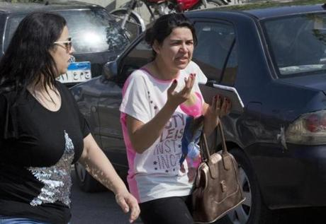 An Egyptian woman, who said her brother is among passengers, grieves as she leaves the Egyptair in-flight service building where relatives are being held at Cairo International Airport, Egypt, Thursday, May 19, 2016. Egyptian aviation officials say an EgyptAir flight from Paris to Cairo with 66 passengers and crew on board has crashed. The officials say the search is now underway for the debris. (AP Photo/Amr Nabil)