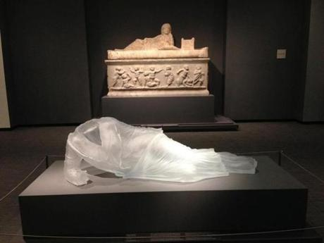 "Karen LaMonte's (cq) translucent cast-glass dress, ""Reclining Drapery Impression,"" at the Chrysler Museum of Art."