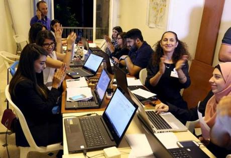 Beirut Madinati candidates and delegates cheered while monitoring ballot counts for the municipality elections after closing the polling stations during Beirut's municipal elections in May.
