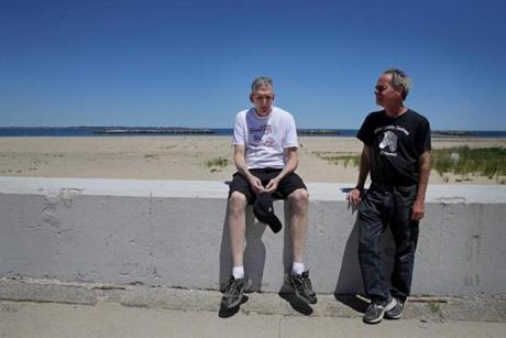 Joathan Rodis (left) made a rest stop during a walk in Winthrop with his longtime friend, Lloyd Caplan. Rodis has Marfan syndrome, a genetic disorder.