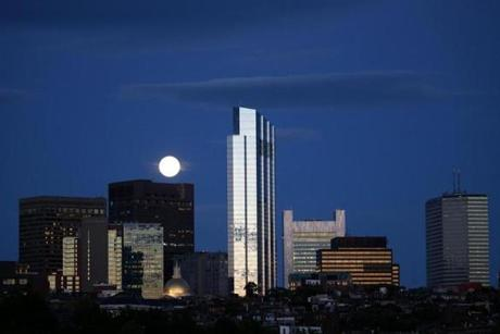BOSTON, MA - 7/20/2016: A FULL MOON VIEW for the Milllennium Tower Boston, downtown crossing at Summer and Washington streets.... Beacon Hill in the foreground an architecture review (David L Ryan/Globe Staff Photo) SECTION: ARTS TOPIC 17Tower