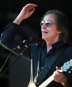 08/03/16: Boston, MA: Jackson Browne is pictured with Fenway Park reflected in his glasses as he opens for James Taylor (not pictured) at Fenway Park. (Globe Staff Photo/Jim Davis) section:living topic: 05taylor