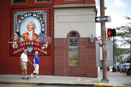 28retirement - A couple walk past a newly commissioned mural in downtown Butler, Pennsylvania on August 16, 2016. ()