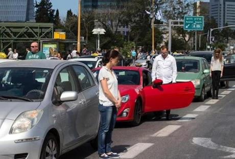 People stopped and stood in silence on a highway in Tel Aviv in May.