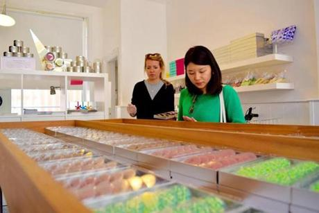 An employee helps a customer at Paxton Chocolates in the Shoreditch neighborhood of London.