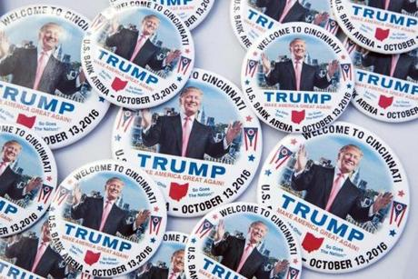 Campaign buttons in support of Republican presidential candidate Donald Trump rest on a vendor table before a campaign rally in Cincinnati on Thursday.