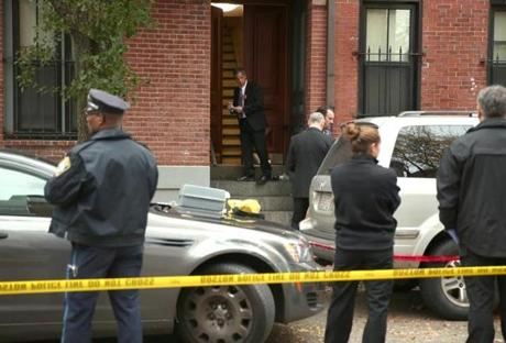 Boston police, with the cooperation of the district attorney's office, gathered clues at the residence on Shawmut Avenue.