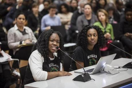 Boston Latin School students Meggie Noel, left, and Kylie Webster-Cazeau speak to a city committee about their student-led racial insensitivity awareness campaign, in Boston, Jan. 27, 2016. The two said that BLS, the country's oldest public school, has failed to respond adequately to online hate speech from classmates. �It just felt like what we go through every day was completely disregarded,� said Noel, 17. (Shiho Fukada/The New York Times)