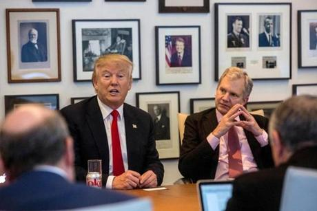 President-elect Donald Trump, left, and New York Times Publisher Arthur Sulzberger Jr., right, appear during a meeting with editors and reporters at The New York Times building, Tuesday, Nov. 22, 2016 in New York. (Hiroko Masuike/The New York Times via AP)