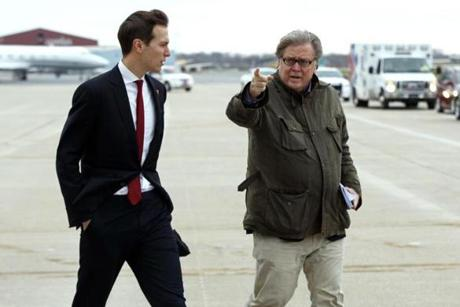 Jared Kushner, son in-law of President-elect Donald Trump, left, walked with Trump's chief strategist Steve Bannon at Indianapolis International Airport on Thursday.