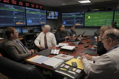 Officials at TSA's command center in Arlington, Virginia, hold a daily call with airport and airline representatives from around the country to share metrics and prepare for spikes in travel.