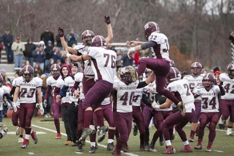 Millis-Hopedale players celebrate after defeating Maynard in the MIAA Division 4A Super Bowl at Worcester State University in Worcester, Massachusetts on December 3, 2016. Millis-Hopedale defeated Maynard 30-18. Matthew Healey for The Boston Globe (SPORTS - Assigning Editor: Joanne Strohmeyer - Story Editor: Craig Larson)