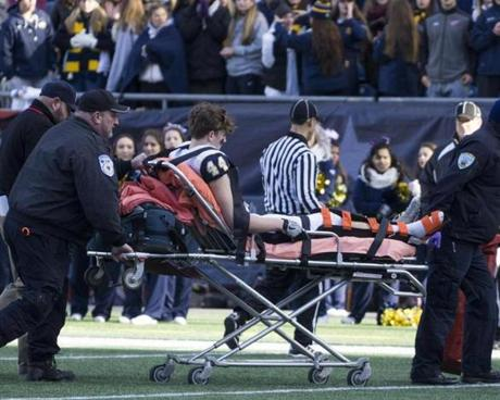 8.3.862095736_Sports_04d3abowl St. Mary's tight end Matt Cross (44) is taken off the field after breaking his leg during the division 3a game at Gillette Stadium in Foxborough, Mass., Saturday Dec. 3, 2016. East Bridgewater defeated St. Marys of Lynn 34-8 to capture the title. (Robert E. Klein for the Boston Globe)