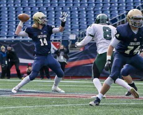 8.3.862095736_Sports_04d3bowl Under pressure from Grafton's Sean Deely (8), Hanover quarterback Wyatt Shisler (14) throws a pass during the Division 3 Super Bowl at Gillette Stadium in Foxborough, Mass,, on Saturday, Dec. 3, 2016. Hanover defeated Grafton 21-0 for the Super Bowl title. (Robert E. Klein for the Boston Globe)