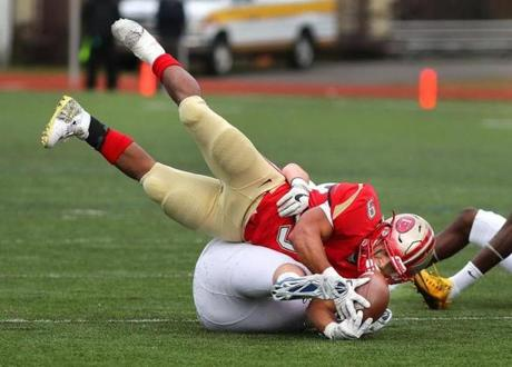Lynn-12/03/2016- Division 1 Superbowl- Everett vs Xaverian - Marvens Fedna runs for a short 2nd qtr gain before being brought down. John Tlumacki/Globe Staff (sports)