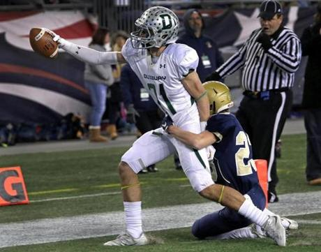 Foxborough, MA - 12/03/2016 - Duxbury Dragons wide receiver David Colucci (21) extends for a touchdown run despite the efforts of Shrewsbury Colonials defensive back Aidan Brown (23). MIAA Super Bowls: Division 2 Shrewsbury vs. Duxbury at Gillette Stadium in Foxborough. - (Barry Chin/Globe Staff), Section: Sports, Reporter: Trevor Hass, Topic: 04HS Super Bowls, LOID: 8.3.862095835.