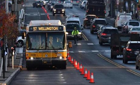 08bus - An MBTA bus drives down a dedicated lane converted from parking spaces on Broadway in Everett during a one week trial. The MBTA could use the project as a way to encourage other bus-only lane tests in traffic-snarled Boston. (Josh Reynolds for The Boston Globe)
