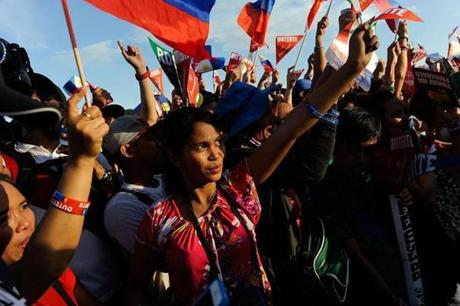 MANILA, PHILIPPINES - MAY 07: Supporters of presidential frontrunner Rodrigo Duterte cheer during his final campaign rally on May 7, 2016 in Manila, Philippines. Duterte, a tough-talking mayor of Davao in Mindanao has been the surprise pre-election poll favourite pulling away from his rivals despite controversial speeches and little national government experience. Opinion polls has shown Mr Duterte has maintained a clear lead in the Philippines as Senator Grace Poe looks at impossible odds. The Philippine presidential campaign ends on May 7 with elections slated for May 9 and features 5 presidential candidates vying for the top post. (Photo by Dondi Tawatao/Getty Images)