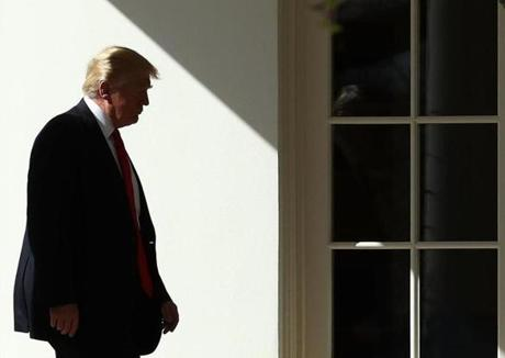 Trump walked to the Oval Office on Friday after returning to the White House.