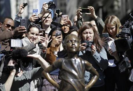 "People photographed the ""Fearless Girl"" statue. She makes a difference."""