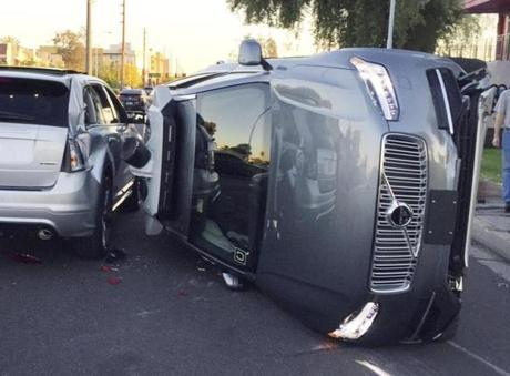 This March 24, 2017, photo provided by the Tempe Police Department shows an Uber self-driving SUV that flipped on its side in a collision in Tempe, Ariz. The crash serves as a stark reminder of the challenges surrounding autonomous vehicles in Arizona. (Tempe Police Department via AP)