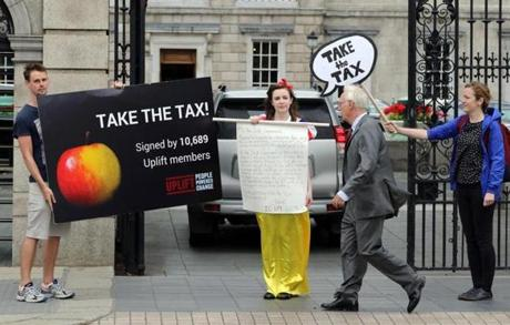 The European Union has been aggressively cracking down on tax avoidance by multinationals. Apple's use of an Irish subsidiary to lower its tax bill by $14.5 billion, according to the EU, draws protesters outside the parliament building in Dublin.