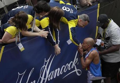 Meb Keflezighi kissed the hand of Bill Richard after running the race.