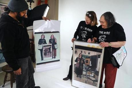 Nafis Azad, left, held up a photo just taken of Dorfman, right, and Margot Kempers.