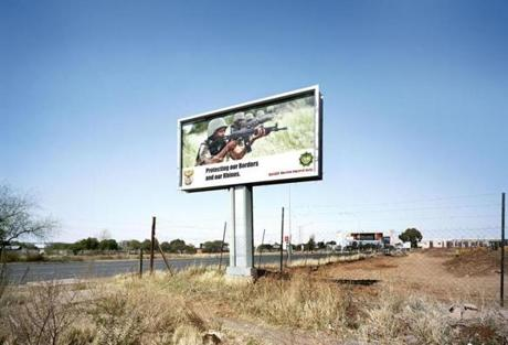 A photograph of a billboard for the South African National Defense Force by Patrick Tourneboeuf.