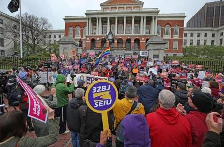 Union and community leaders joined immigrant advocates for a rally at the State House Monday.