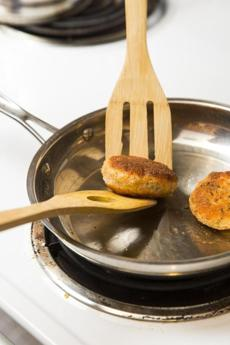 With minimal binder, the salmon cakes are delicate, so I use two spatulas to turn them in the skillet. Support the cakes with one while edging the second one underneath to turn them.