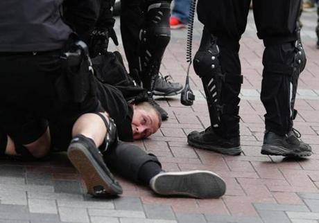 Seattle police took a protester into custody on Monday.