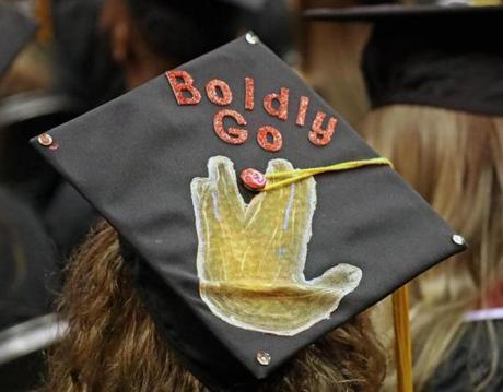 BOSTON, MA - 5/05/2017: GRAD CAPS...... NORTHEASTERN UNIVERISITY GRADS had someting to say on their caps at TD Garden.(David L Ryan/Globe Staff Photo) SECTION: METRO TOPIC 06northeastern