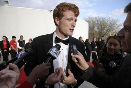 Rep. Joseph P. Kennedy III, D-Mass., speaks with members of the media as he arrives at the John F. Kennedy Presidential Library and Museum before the 2017 Profile in Courage award ceremonies, Sunday, May 7, 2017, in Boston. Former President Barack Obama is to be presented with the award Sunday. (AP Photo/Steven Senne)