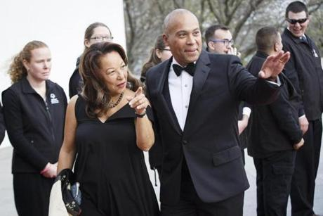 Boston, MA - 5/7/2017 - Former Massachusetts Governor Deval Patrick waves from the red carpet with his wife Diane as they arrive for the annual John F. Kennedy Profile in Courage Award at the the John F. Kennedy Presidential Library and Museum in Boston, MA, May 7, 2017. Former U.S. President Barack Obama was the recipient of the award. (Keith Bedford/Globe Staff)