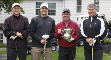 Gene Sauers played a round at Salem Country Club Monday with (left to right) head golf pro Kevin Wood, Patriots kicker Stephen Gostkowski, Sauers, and former Bruin Ray Bourque.