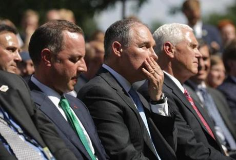 From left to right, Chief of Staff Reince Priebus, EPA Administrator Scott Pruitt and Vice President Mike Pence listeedn as President Donald Trump announced his decision to pull the United States out of the Paris climate agreement Thursday